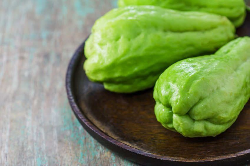 The chayote (Sechium edule) is a vegetable on wooden background
